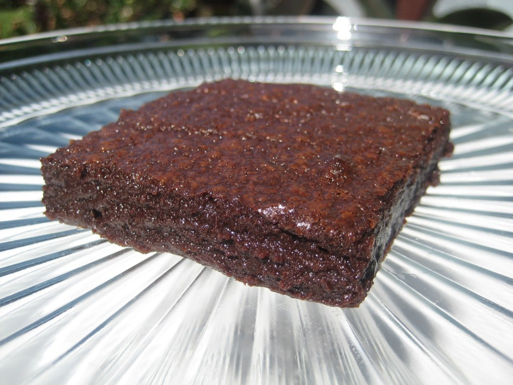 This easy brownie recipe will be in the oven in five minutes. Just dump, stir, and bake! It's fudgy and full of chocolate goodness!