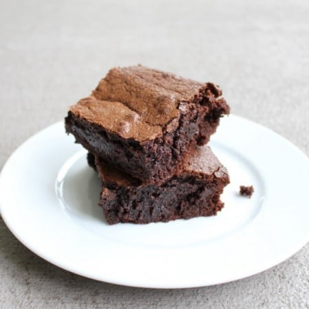 Deep dish brownies on a white plate