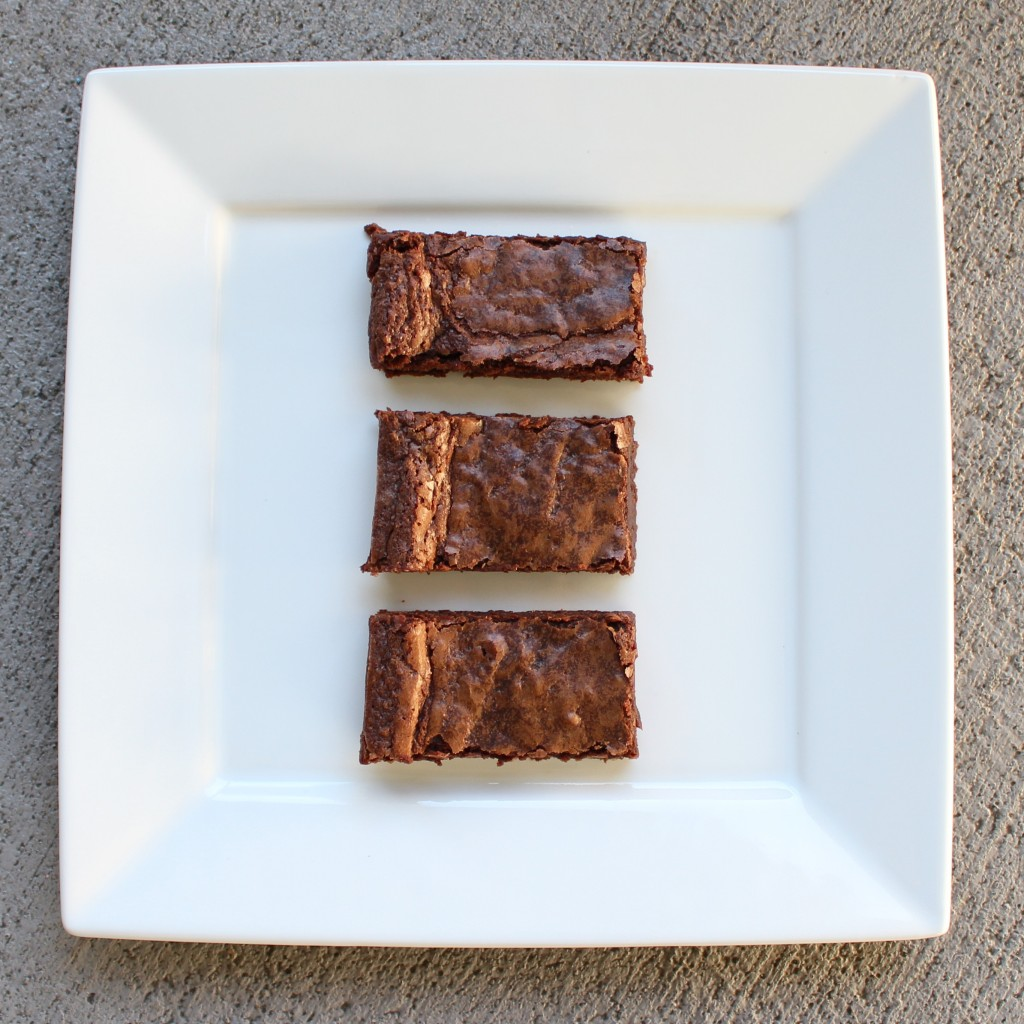85% chocolate brownies on a white square plate