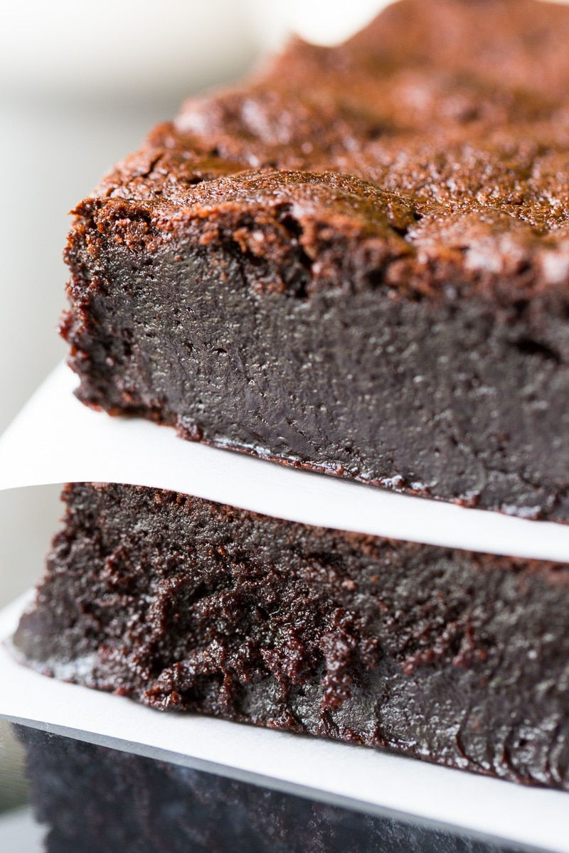 Decadent flourless brownies in a stack