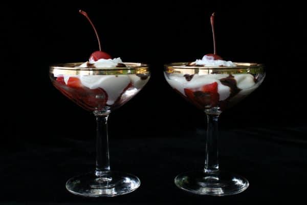 Try this delicious Vanilla Yogurt Sundae with Strawberries, Whipped Cream, Fudge Sauce, and a Cherry!