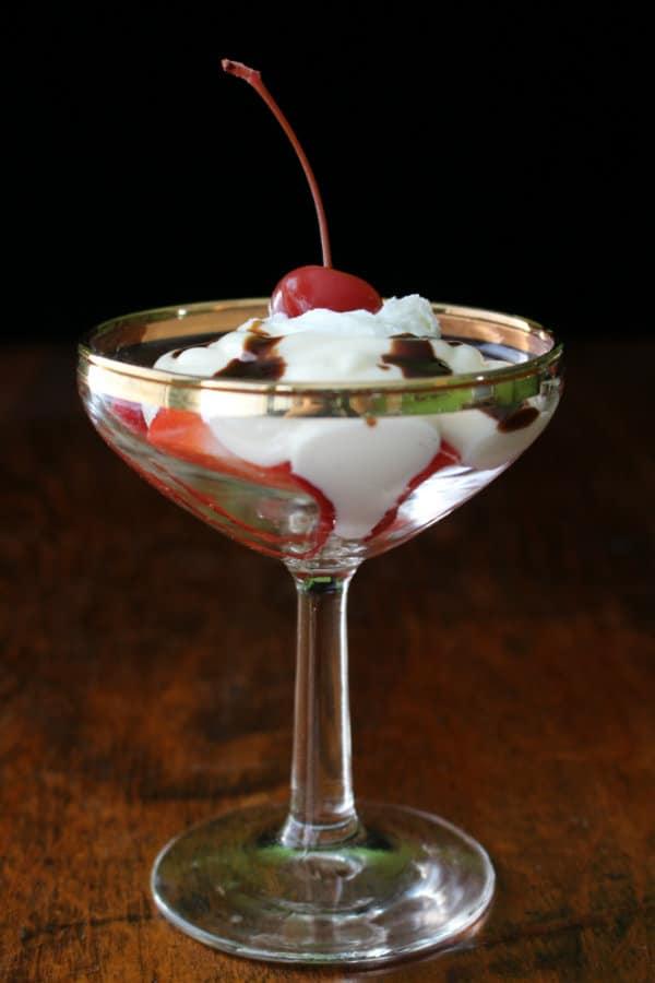 You'll love this yogurt sundae made with creamy vanilla yogurt, fresh sliced strawberries, chocolate sauce, whipped cream, and a cherry!