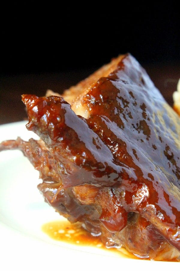 A dry rub of brown sugar and Asian Five Spice powder plus a sweet and savory peanut sauce for basting makes these peanut sauce ribs tasty!
