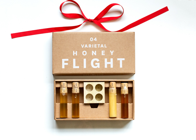 Gift box containing flight of four honeys