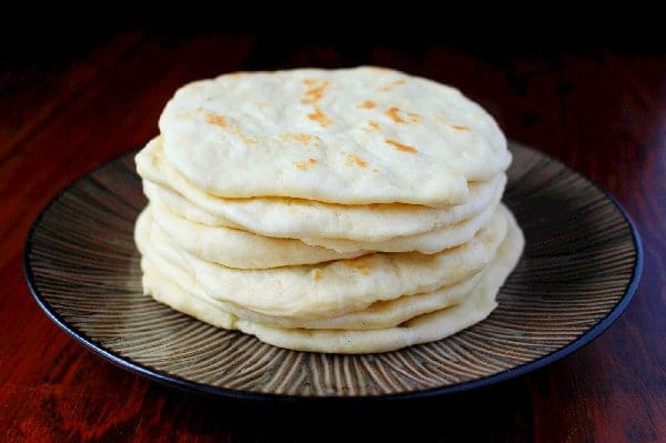 Restaurant Style Flour Tortillas in a stack on a plate
