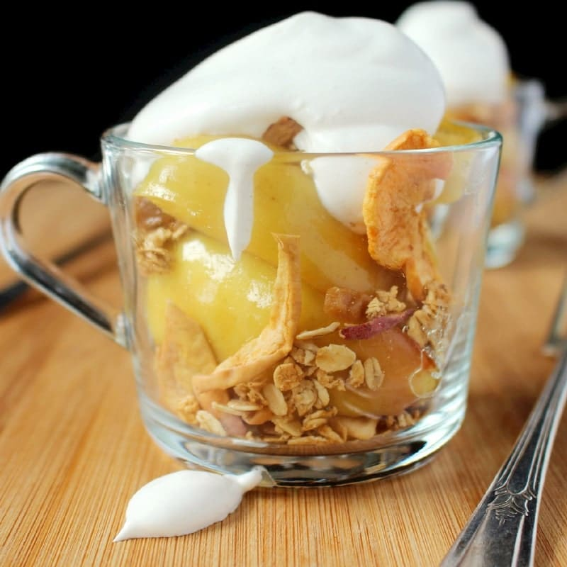 Sautéed apples in a touch of butter and brown sugar are topped with granola and cinnamon whipped cream. Perfect for a dessert or snack!