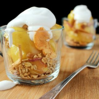 Sautéed apples in a touch of butter and brown sugar are topped with granola and cinnamon whipped cream. Perfect for a light dessert or snack!
