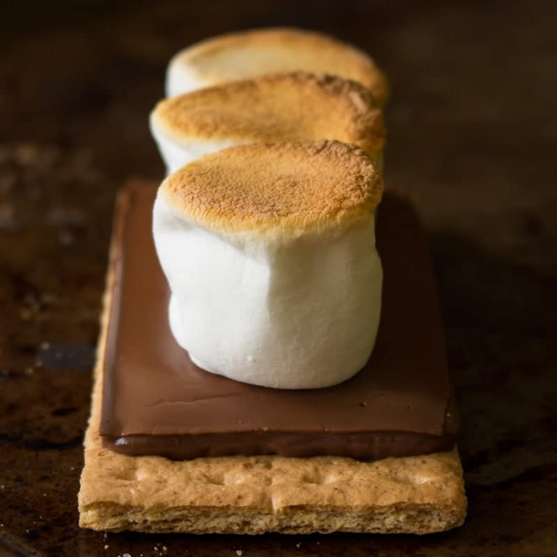 Smores in the oven recipe with marshmallows, chocolate, and graham crackers