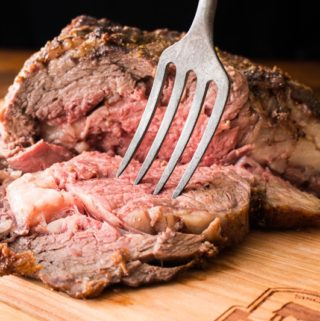 Bone-in rib roast with fork