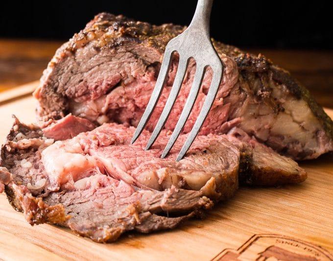 Bone-in rib roast with fork
