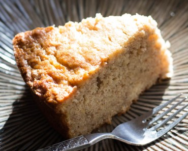 This banana bread cake is moist, flavorful, and has just the perfect kick of dark rum. It's the banana bread cake of your dreams!