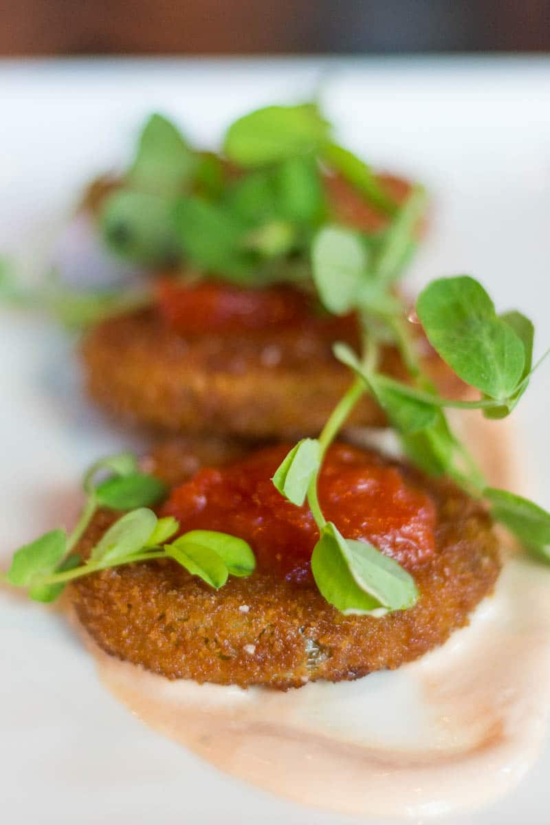 F & D Kitchen and Bar Fried Green Tomatoes with Sauces and Herb Garnish