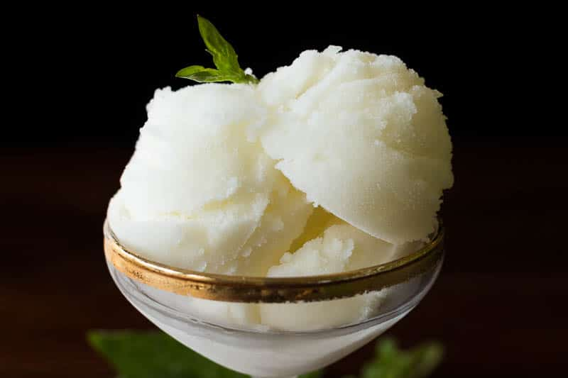 This elegant lemon sorbet is the perfect dessert or palate cleanser, and it's so very easy to make! Only 4 simple ingredients.