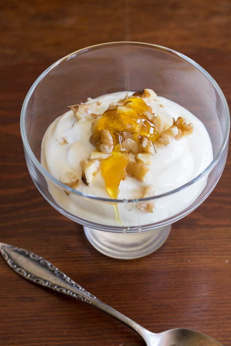 Make this citrusy, refreshing honey tangerine yogurt with walnuts for a snack or for breakfast. It's loaded with protein and it's absolutely delicious!
