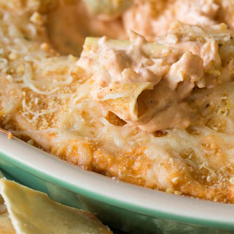 This creamy parmesan rosa baked artichoke dip is full of rich, cheesy goodness with just the perfect tang of tomato flavor. Bake it today and enjoy!