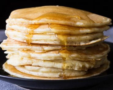 Make pancakes from scratch with this simple and easy recipe. They're fluffy, tasty, more delicious than a box mix, and just as easy to make!