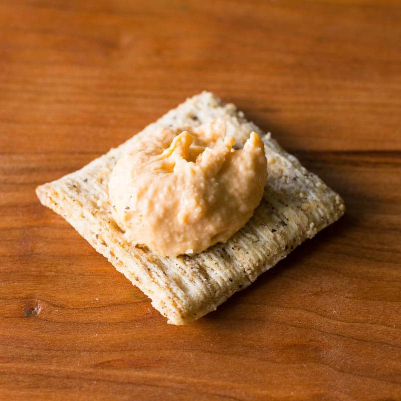 Make this fresh and delicious roasted red pepper hummus recipe with only 5 ingredients in just 5 minutes! It's the perfect appetizer, snack, or side dish.