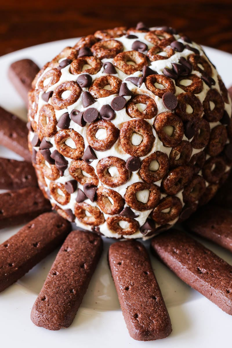 This delicious dessert cheese ball is made with cream cheese, chocolate chips, and Cheerios. It's the perfect dessert to share.
