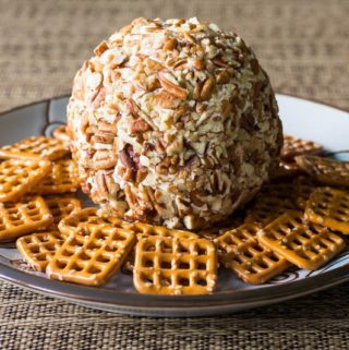 Whip up this easy cheese ball recipe in minutes, using cream cheese, cheddar, and pecans. You'll also get my handy trick for packing up cheese balls to go!