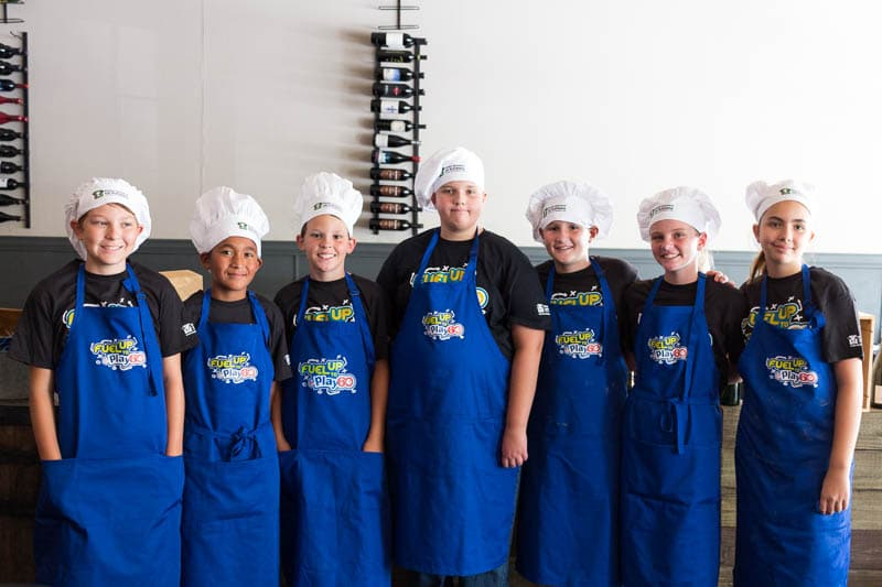 Local students who participated in the Florida Dairy Farmers Gridiron Cooking Challenge prepared a celebratory dinner at Cress Restaurant in Deland, FL.