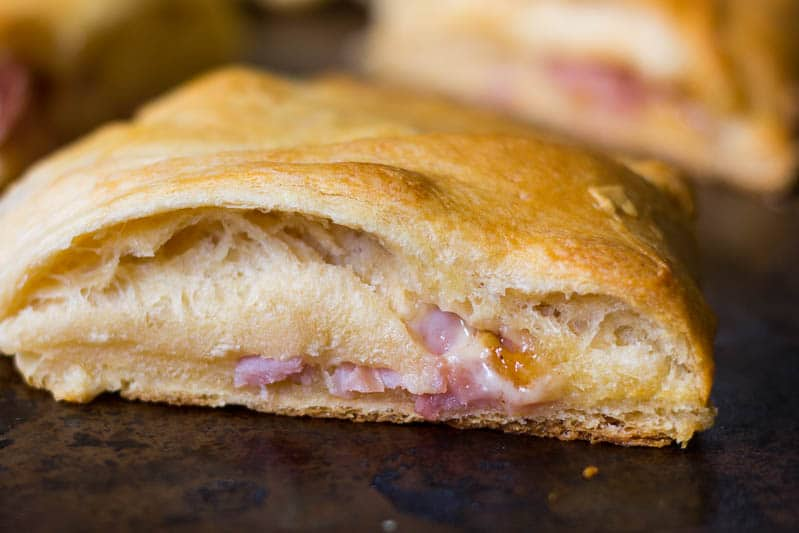This Ploughman's Lunch Crescent Roll Ring takes the traditional ploughman's lunch and gives it a twist, combining ham, English cheese, and chutney in a delicious crescent roll ring.