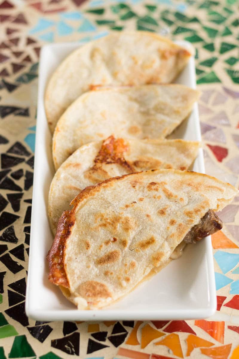If you've never used corn tortillas to make steak quesadillas, you're in for a treat! This steak quesadilla recipe is super easy and so delicious.