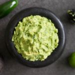 This spicy guacamole recipe is made with fresh avocados, jalapenos, lime juice, and sea salt. It's perfect for guacamole lovers who love a little heat!