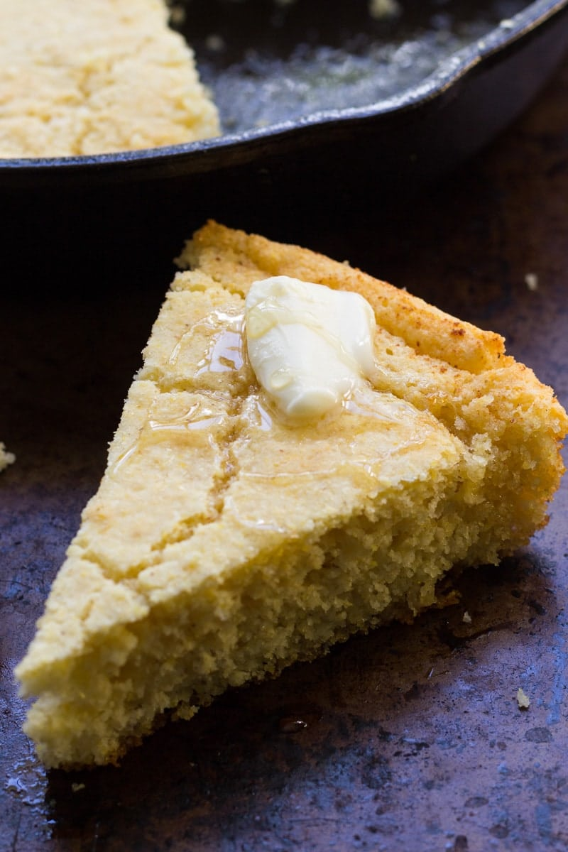 This classic Southern cast iron skillet cornbread is my mother's recipe. You'll love the savory buttermilk flavor and the deliciously crunchy crust!