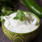 This cucumber raita recipe is made with whole milk yogurt, cumin, cilantro and seedless cucumbers. A perfectly cool and refreshing dip!