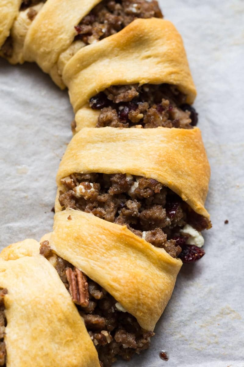Crescent roll ring stuffed with crumbled pork sausage, cranberries, pecans, and goat cheese. A perfect appetizer or party platter!
