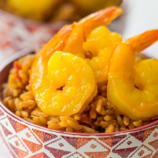 Sauteed saffron shrimp are a beautiful yellow color with a delectable flavor. Ready in just minutes with a simple white wine and saffron marinade!