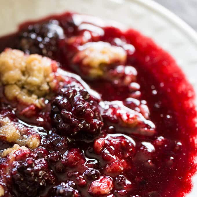 Closeup of cooked blackberry in blackberry crumble