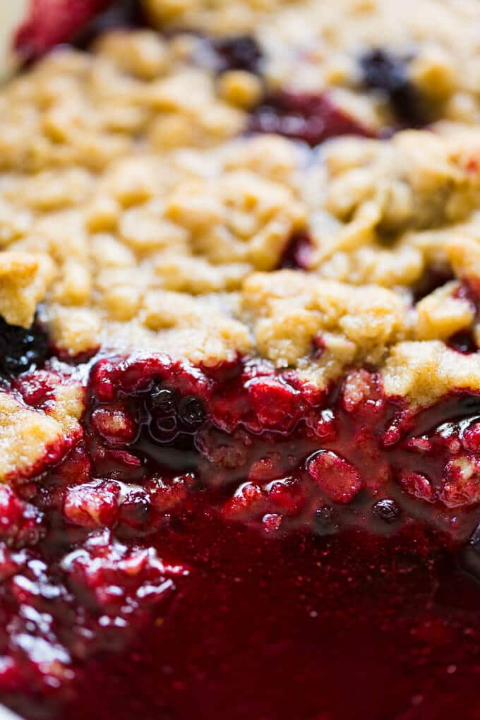 Closeup inside blackberry crumble with juice