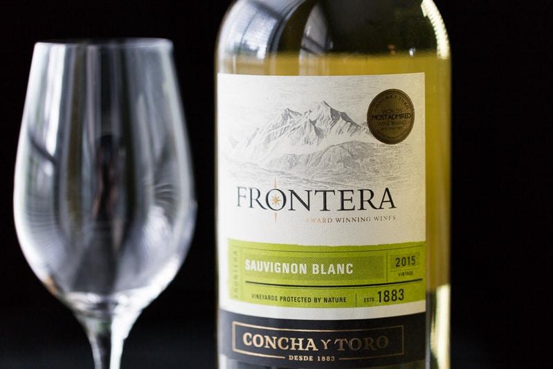 Frontera Sauvignon Blanc with glass