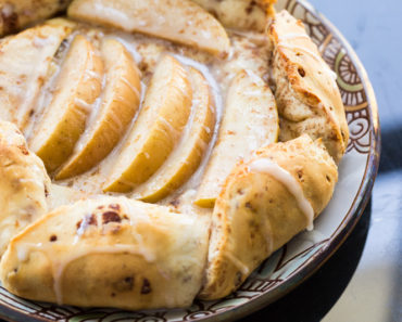 This cinnamon roll apple galette is a fun twist on the traditional French galette, using cinnamon roll dough wrapped around apples.