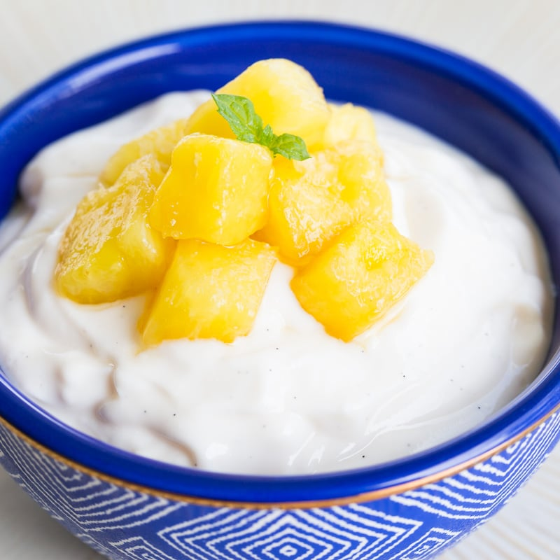 Fresh Pineapple Topping on yogurt in a blue bowl