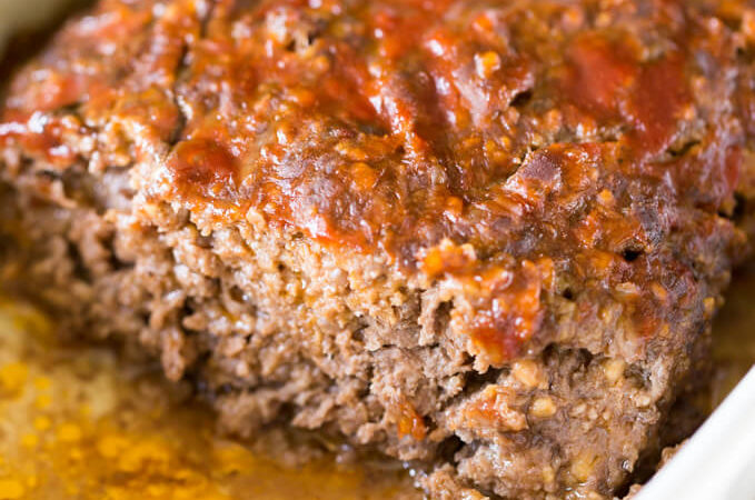 Slice of ketchup glazed meatloaf without eggs