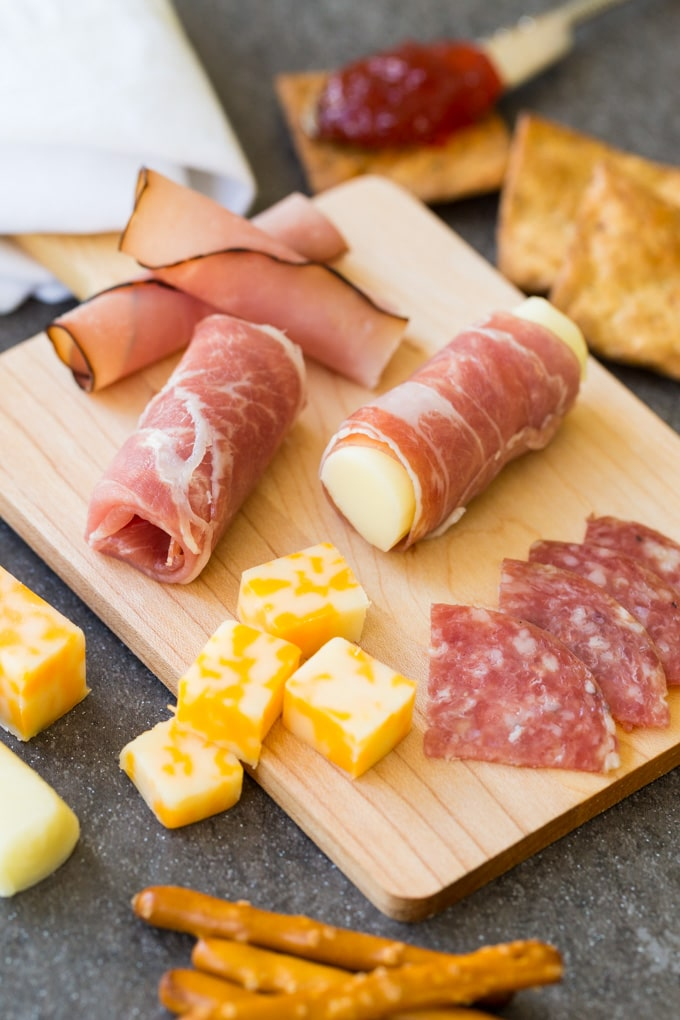Charcuterie board with prosciutto, maple ham, salami, and cheese