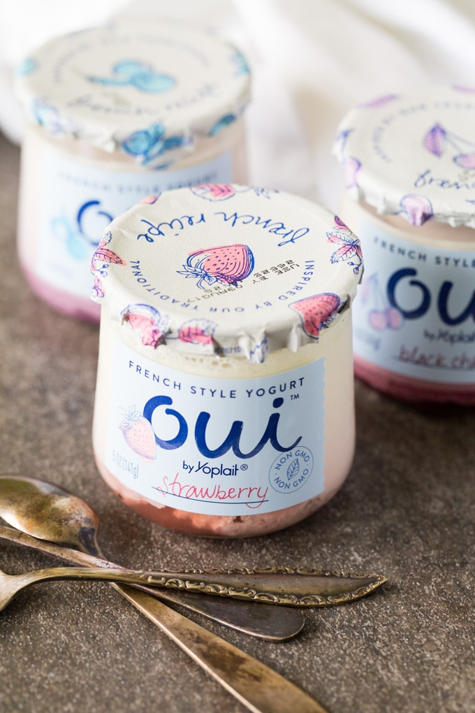 Three glass containers of Oui French Yogurt with spoons