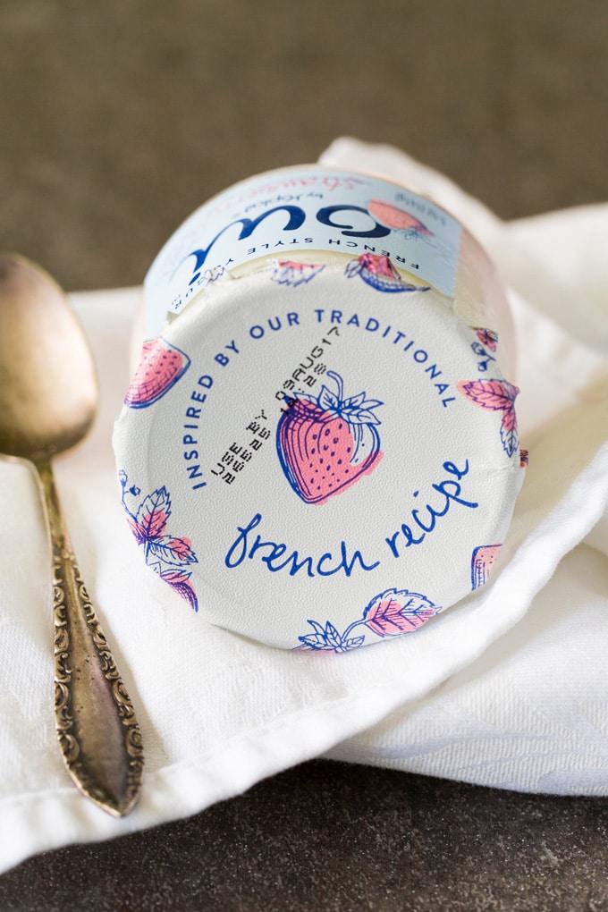 Lid of Oui by Yoplait strawberry French yogurt