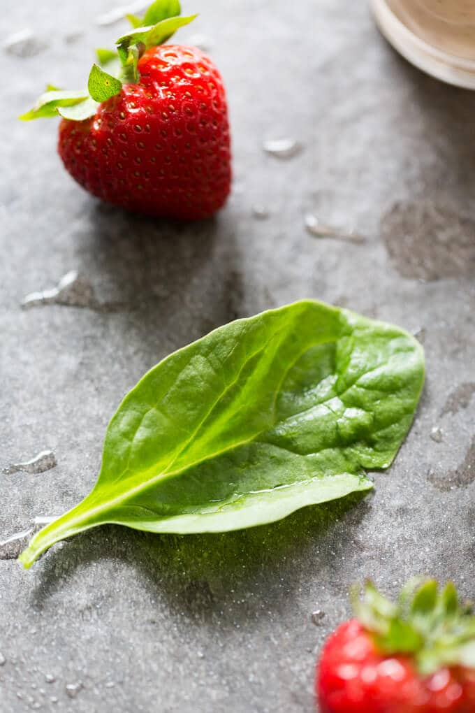 Spinach leaf and strawberries