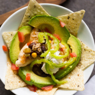 Chicken Taco Bowl entree in a white bowl with white cloth napkin and wooden spoon
