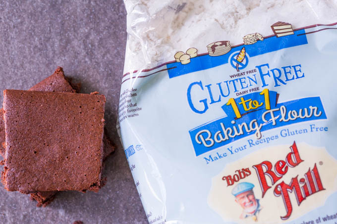 Bob's Red Mill Gluten Free 1 to 1 flour next to a stack of chocolate brownies