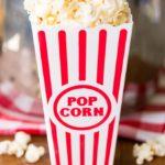 Popcorn in a red striped popcorn bucket