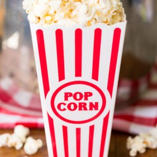 Popcorn in a red striped popcorn bucket