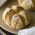 Two round loaves of gluten free irish soda bread on a baking stone