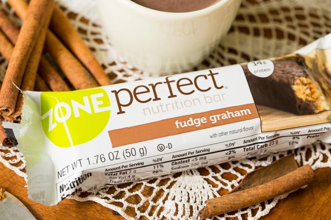 ZonePerfect Double Dark Chocolate bar with cocoa and cinnamon on a lace doily