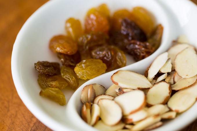 Golden raisins and sliced almonds for Moroccan rice