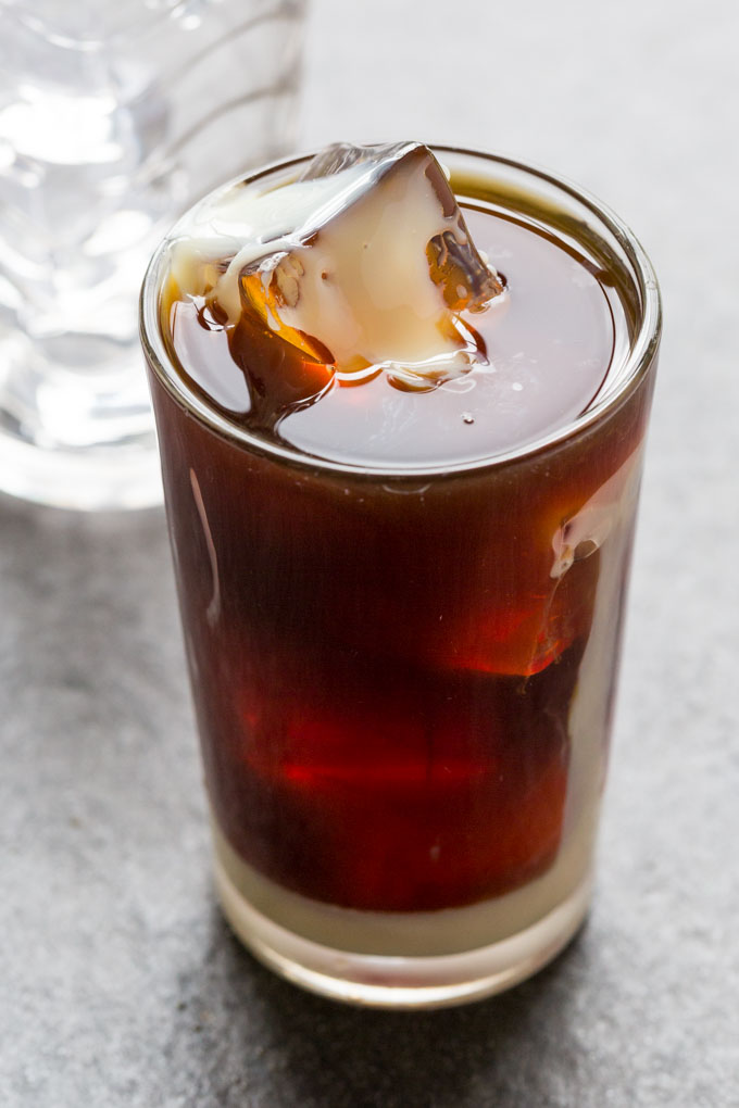 Cold brew iced latte in a clear glass with ice