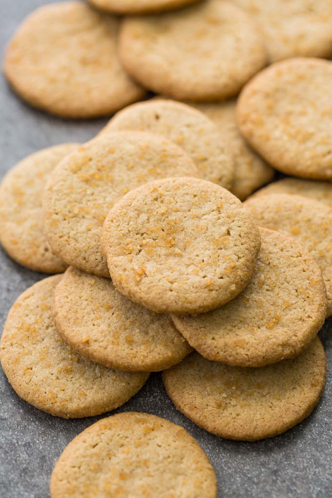 Large pile of gluten free shortbread rounds